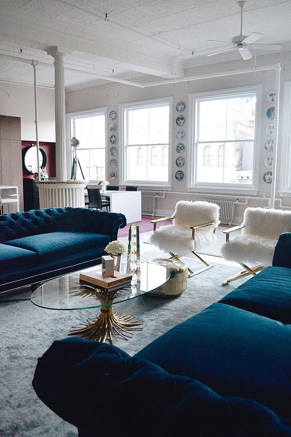 persian blue velvet couches, white + brass textured chairs + the gorgeously detailed coffee table - so glam