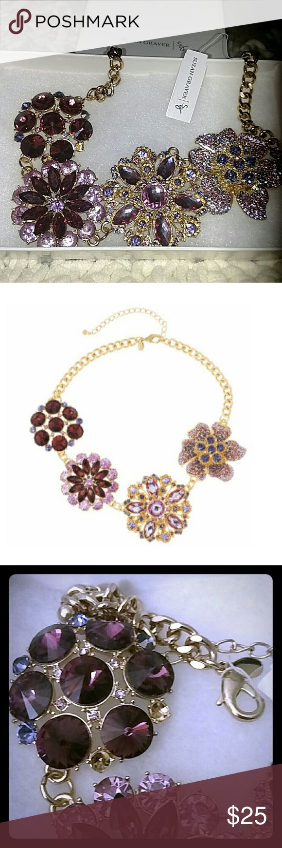NWT Susan Graver statement necklace NWT gold and shades of purple statement necklace.  4 large flowers with lots of sparkle. 2 gem stones are missing (see picture number 3).  Priced accordingly.  Great deal. Susan Graver Jewelry Necklaces