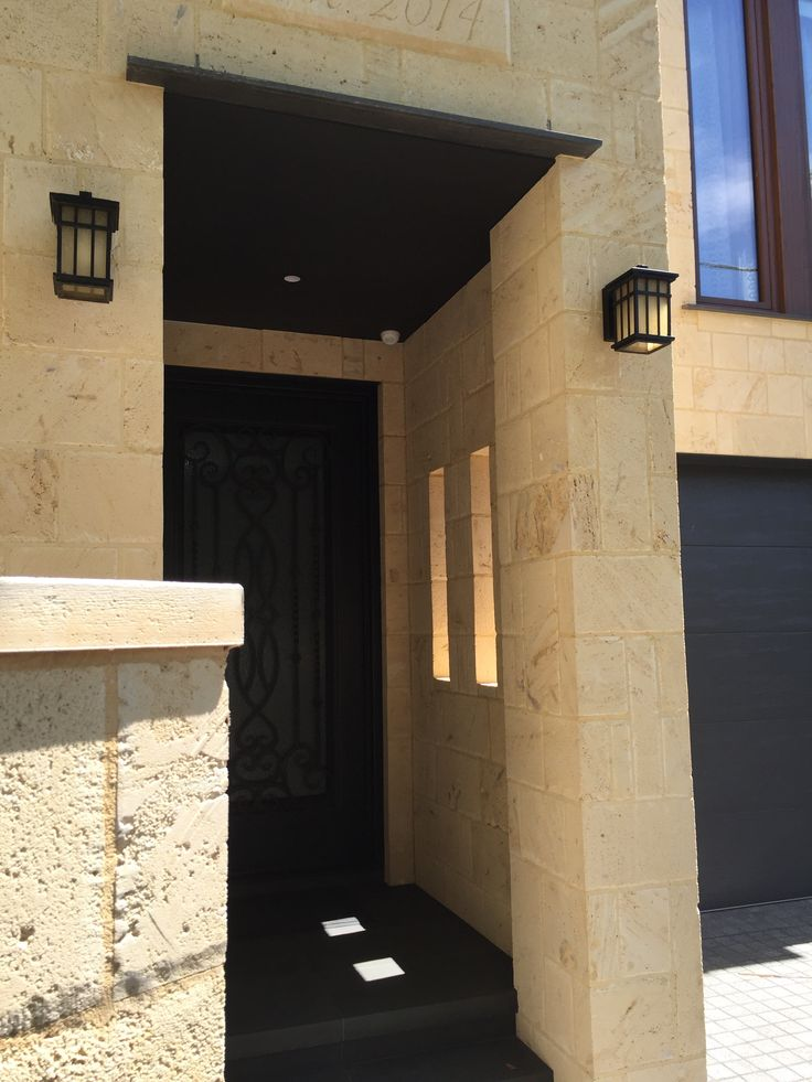 Welcome home. Front entrance featuring our Cream Limestone.