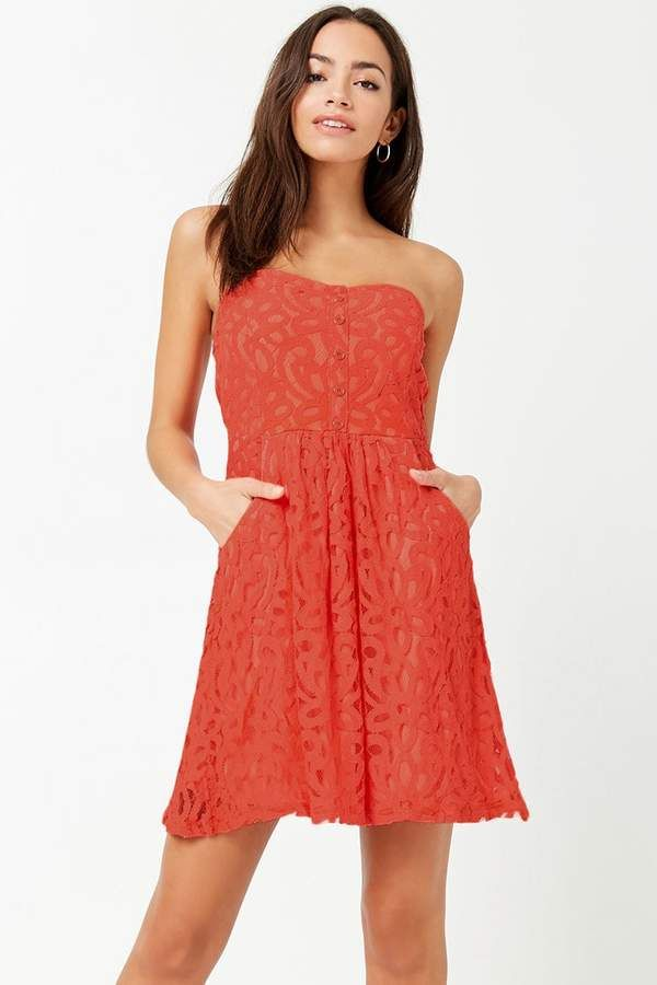 2e2df6aac56 Forever 21 Lace Mini Tube DressA knit tube dress featuring an embroidered  lace design