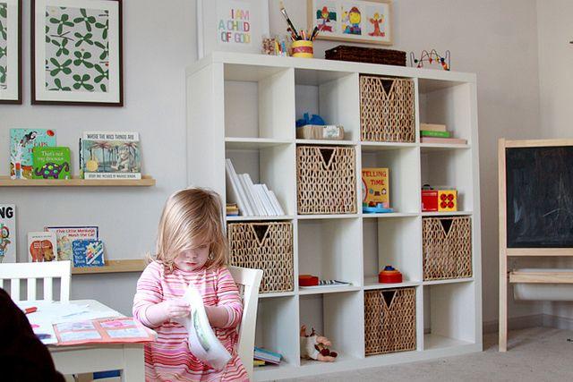 Ikea bookshelf and baskets for boys' playroom