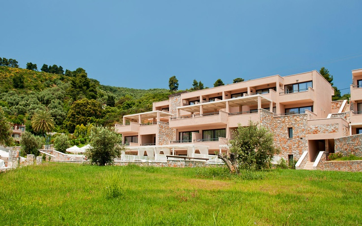 The Kassandra Bay main building, with it's back to the green of Skiathos, facing the Aegean sea. Visit www.kassandrabay.com/resort-overview for more info.