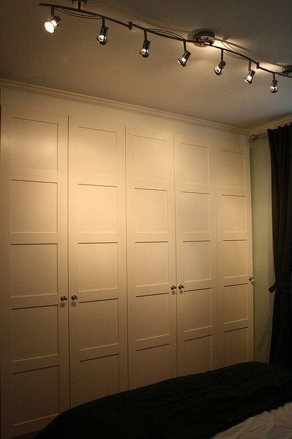 Upstairs hallway?...ikea pax with filler and crown – good idea for basement storage
