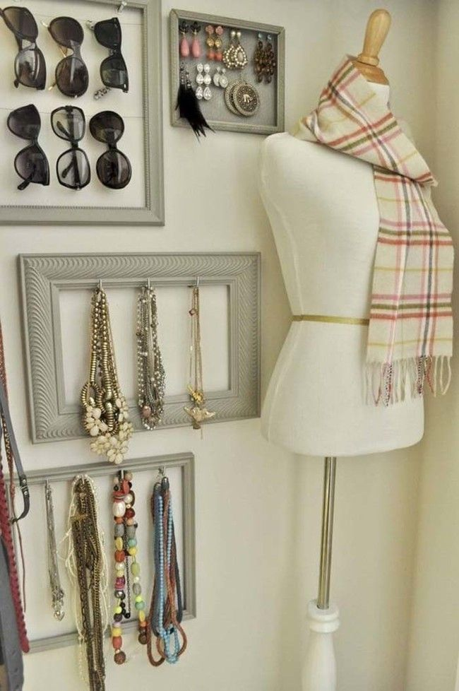 If you're going for a more elegant organizational display, put hooks on picture frames to store jewelry.