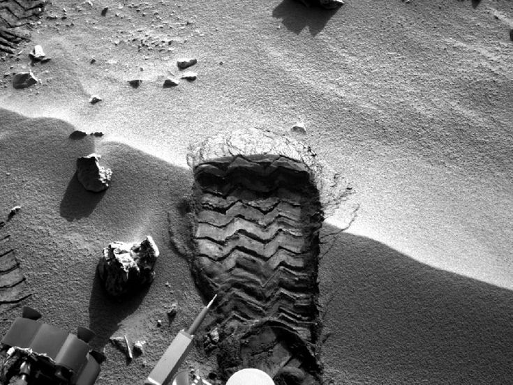 """NASA's Mars rover Curiosity cut a wheel scuff mark into a wind-formed ripple at the """"Rocknest"""" site to give researchers a better opportunity to examine the particle-size distribution of the material forming the ripple. The rover's right Navigation camera took this image of the scuff mark on the mission's 57th Martian day, or sol (Oct. 3, 2012), the same sol that a wheel created the mark."""