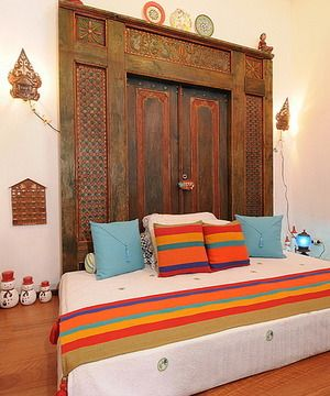 Antique Indonesian Doors from Java as headboard.