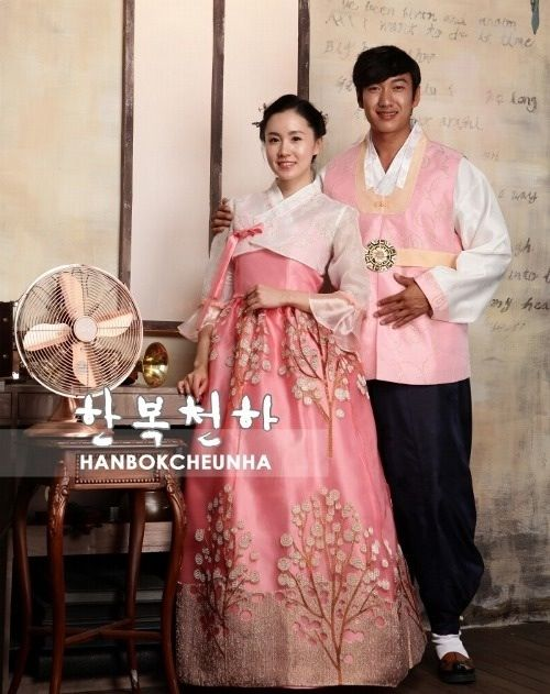 Wedding-style modern hanbok, men's and women's. Pink with embroidered trees and a sheer, white jeogori. White and pink with daisies. Green and sheer pink with traditional patterns. Source: Hanbok Cheonha (한복 천하)