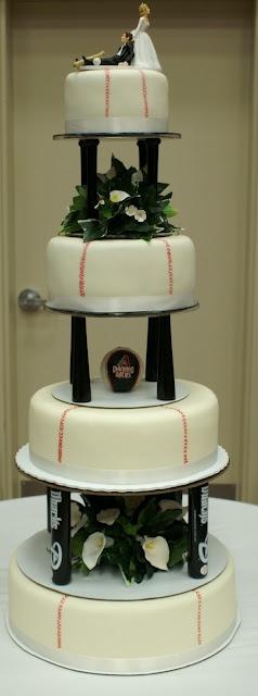 Baseball Theme Wedding Cake...@Vicki Schaewe I'M SOLD!!! FAVORITE FLOWER AND THEME