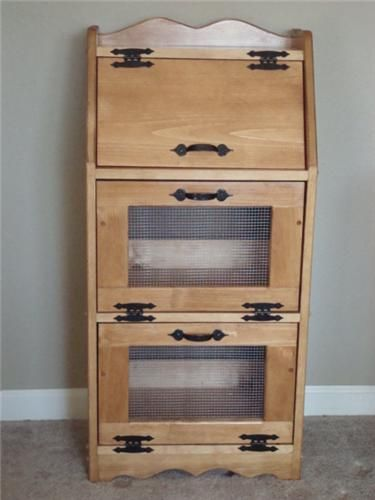 This handcrafted vegetable/bread bin features an area on top for chips, cookies, bread, and other dry snacks, with two vented bins below for vegetables and fruits.