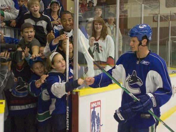 Kevin Bieksa in Terrace BC. Good job juice makin kids happy
