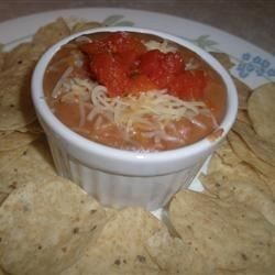 Zesty Bean Dip - Allrecipes.com  I want to try and recreate Tostitos Zesty Bean and Cheese Dip. Thinking of adding jalapenos, Monterey Jack cheese, garlic powder and maybe some bell peppers and a splash of milk too.