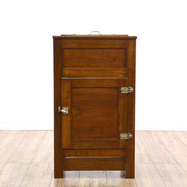 This antique ice box refrigerator is featured in a solid wood with a rustic cherry finish. This cabinet a lift up top with 2 interior cabinets lined with metal. Perfect as a nightstand end table! #americantraditional #storage #cabinet #sandiegovintage #vintagefurniture