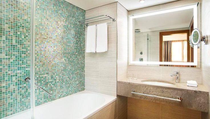 A custom mix of glass mosaic can make your dream bathroom environment unique