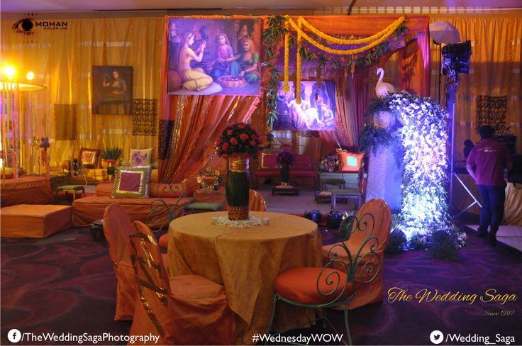 Simple and Serene Saffron theme along with dramatic lighting. #TheWeddingSaga #MohanColorLab #WeddingDecor