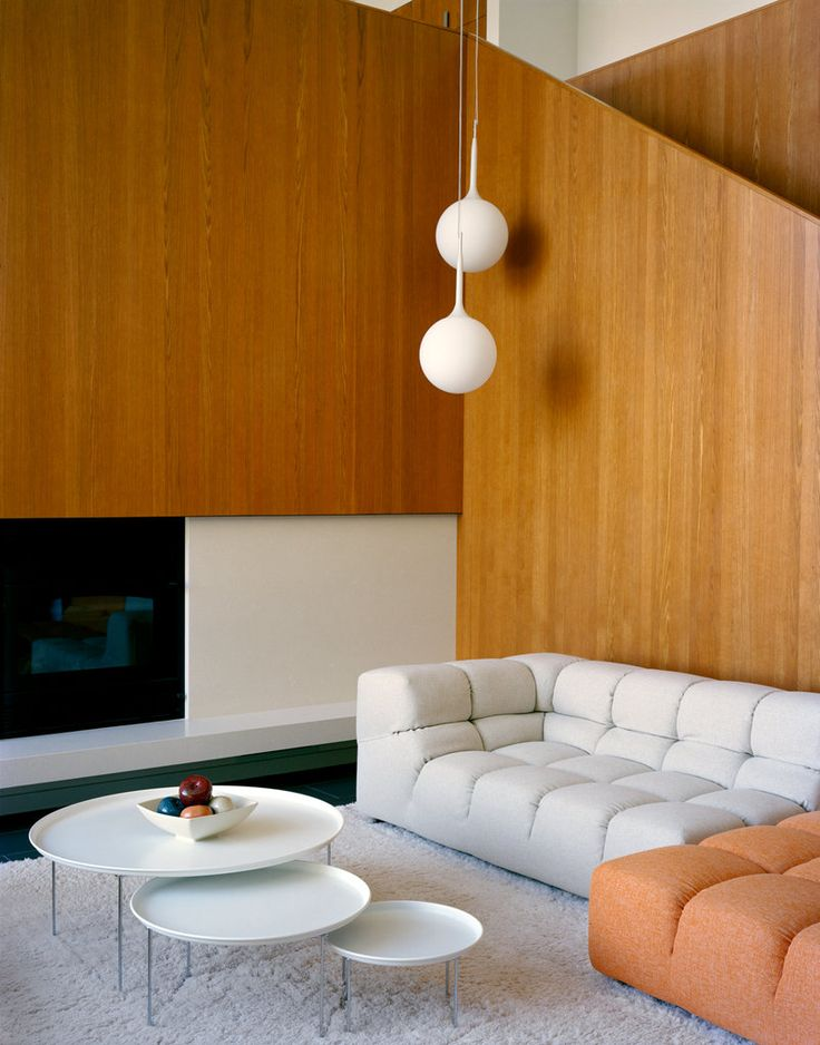 Tufty Time sofa and coffee table from B & B Italia. Love the 1960s style wood panelling too.