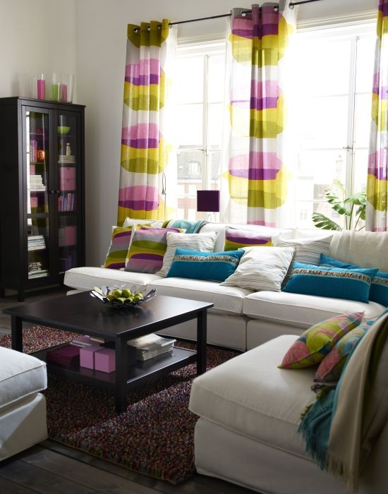 KIVIK done 5 ways! Shown here in a retro-modern style. Colorful, simple, patterned textiles give this room a touch of times past. The multi-colored shag rug completes the look.