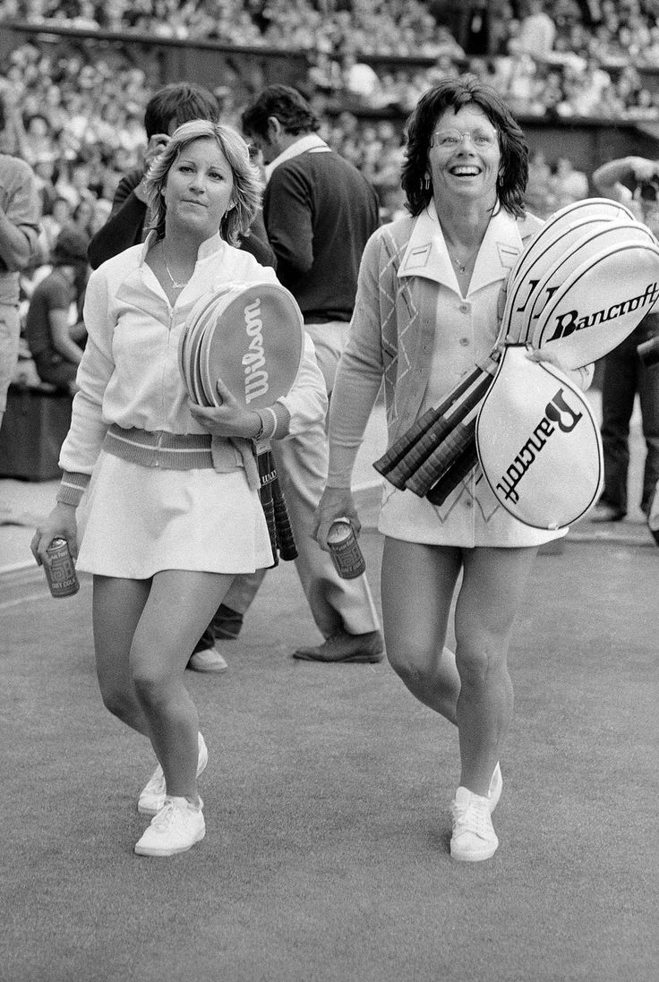 Billie Jean King, right, and defending champion Chris Evert, walk off the Center Court at Wimbledon after their match on Monday, June 27, 1977.
