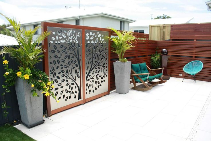 """URBAN METAL : Outdoor Decorative Screens.  Stainless Steel + Timber - a match made in heaven !  Design : Urban Metal """"Tree Of Life"""" Stainless Steel panels were custom framed in timber , creating a stunning combination. Urban Metal . Decorative Screening. Privacy Screens. Light Feature."""