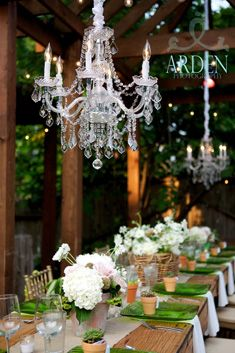I love how fancy chandeliers in a rustic setting - it really transforms a space...