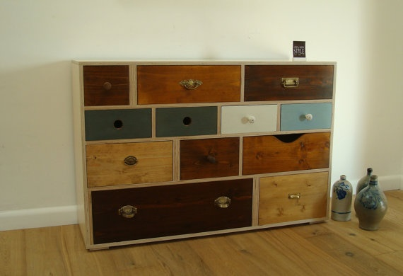 http://www.etsy.com/listing/80643955/dresser-kt2-unic?ref=tre-827679389-3  This guy makes the most amazing dressers out of pieces of old dressers.  I LOVE his stuff!
