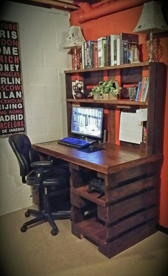 DIY Pallet Computer Desk. I constructed the desk with old free pallets and a pack of cheap hardwood laminate flooring for a smooth desktop finish. Brown walnut staining.