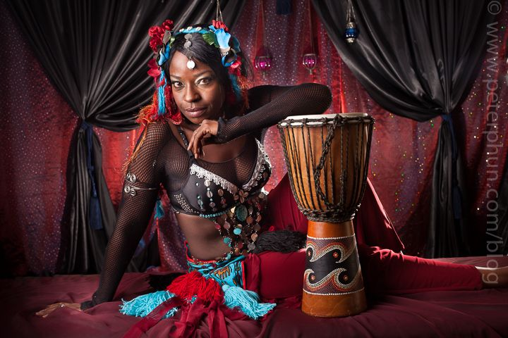 Dee in her tribal costume and matching drum