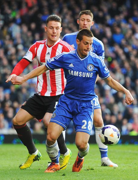 Cesar Azpilicueta of Chelsea holds off Connor Wickham of Sunderland during the Barclays Premier League match between Chelsea and Sunderland ...
