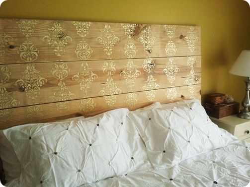 stencil on reclaimed wood headboard