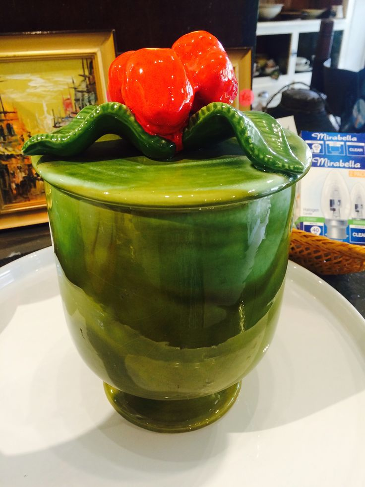 Striking american made mixed green jar and strawberry lid.   Currently on shop floor. For more details please visit us on our Facebook page https://www.facebook.com/Whatever-at-Willunga-118129198383581/timeline/ or our website.