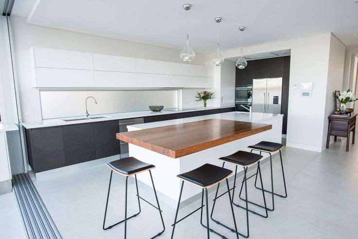 Modern Waterfront home in Sydney | Modern Home | Contemporary house | Sydney architecture | beach house | modern interior | white minimalist design | partition wall | glass sliding doors | designer table | designer chairs | dining room | modern kitchen | white bench top | butlers pantry |