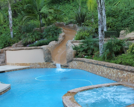 Pool Designs With Rock Slides swimming pool with rock waterfall grotto and rock water slide Rock Slide Design Pictures Remodel Decor And Ideas