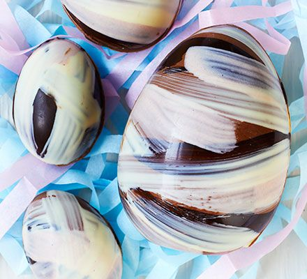 Striped chocolate Easter egg. Make your own beautiful homemade Easter gift, using milk, white and plain chocolate, with our ultimate step-by-step guide!