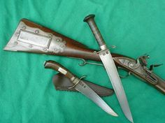 Daniel Casey knives and Rifle.