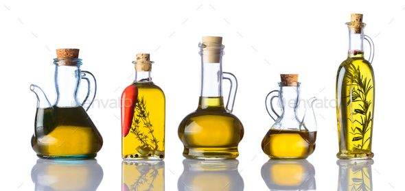 Bottles Of Cooking Oils On White Background By Oizostudios