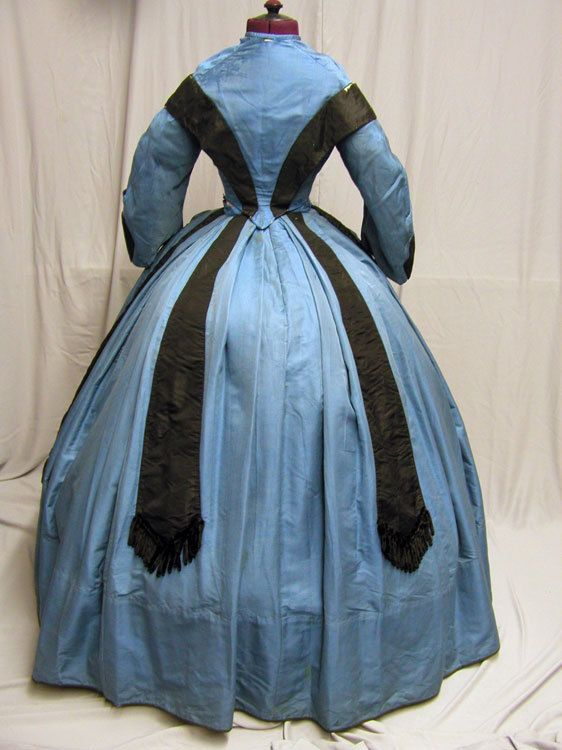 1860's Blue silk dress, back view showing the black trim application.