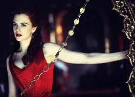 Moulin Rouge red corset dress in action, as if you could forget what it looks like.