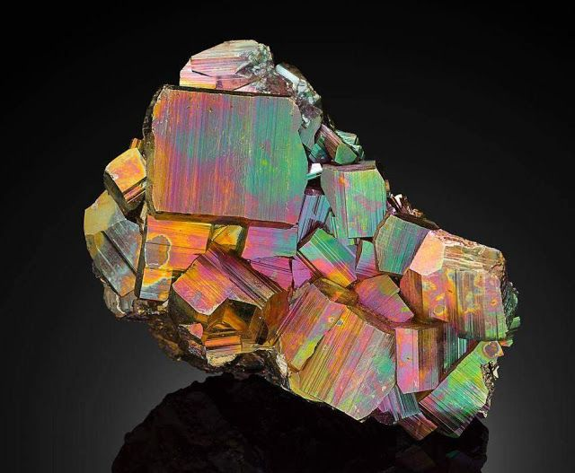 Rainbow pyrite, a variety of mineral pyrite. The iridescence is caused by tarnishing by oxidation and molybdenum traces in the mineral. Photo: Ryan lay Aventurescence Aventurescence is named after Aventurine Feldspar, which is also known as Sunstone. This type of iridescence is due to the play of color caused by reflection on tiny, thin inclusions of goethite and hematite (or both). This gives the stone a golden or reddish-brown color and specular reflections.