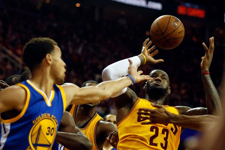Golden State Warriors' Stephen Curry (30) and LeBron James (23) struggle on a rebound in the third quarter of Game 4 of the NBA Finals at Quicken Loans Arena in Cleveland, Ohio, on Thursday, June 11, 2015. (Nhat V. Meyer/Bay Area News Group)