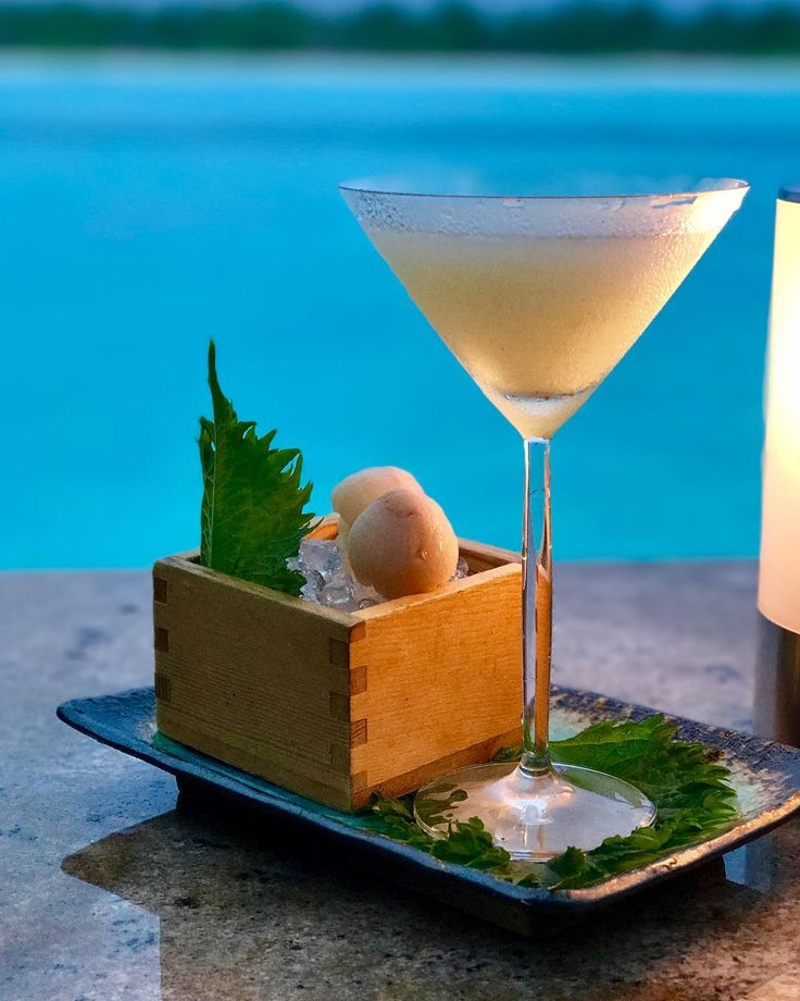 Sampling the Wasabi Lychee Saketini with the amazing clear blue waters of the island. #drinks #alcohol #martini #islandlife #travel