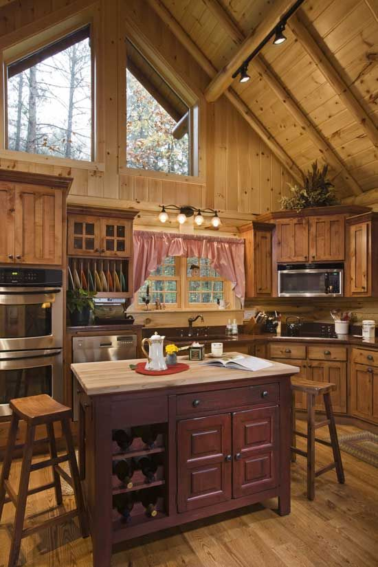 Large upper windows bring natural light into the home's U-shaped kitchen.