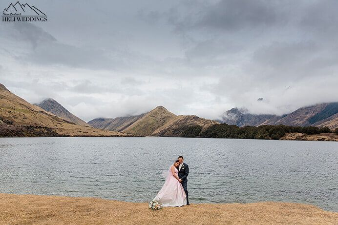 Husband & wife on their wedding day at Moke Lake, Queenstown, NZ
