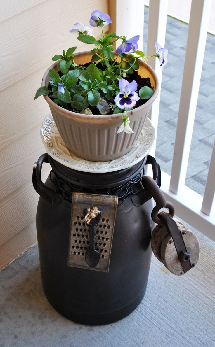 milkcan with flowers on top