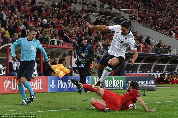 Central midfielder Emre Can rides the challenge of Spartak defendeGeorgi Dzhikiya during the second half in Moscow