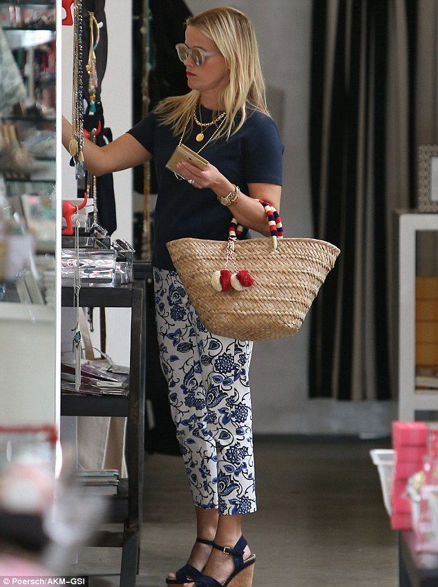 Shopping time: The Oscar-winning actress carried a straw purse while shopping in Beverly H...