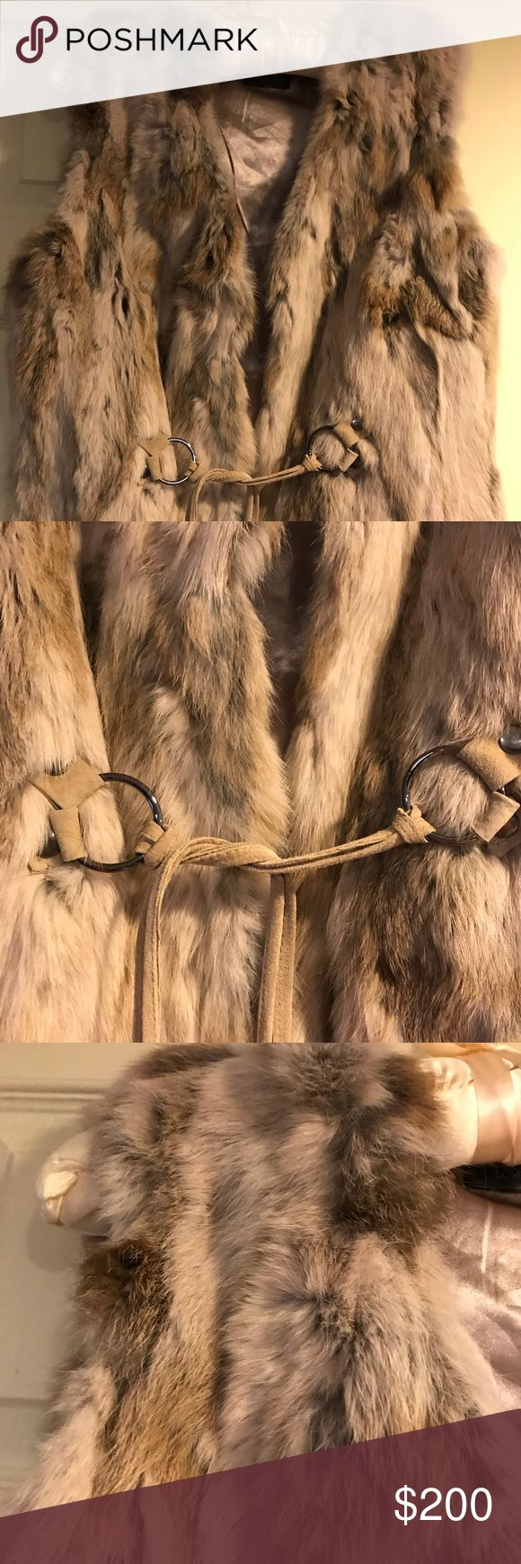 Real Fur Vest Soft and light Vest, in makes you feel amazing in any weather, my pictures don't do the Vest Justice. It is brand new with tag, size runs smaller . Color is cream so it's lighter than pictures. The Fur is long Rabbit hair in front and back. Love Token Other