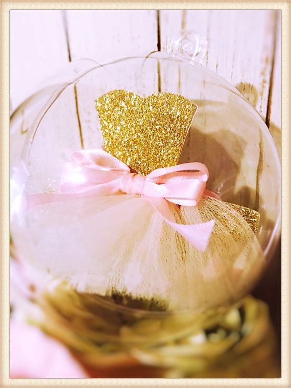 A Ballerina ornament for your ballet party or a Christmas ornament. Weve taken the concept of a Ballerina party and elevated it high quality glitter cardstock. This Ballerina decoration is further distinguished with the use of real tulle and ribbon, making it a three-dimensional ornament.  The ornament ball is plastic, we took in mind the little ballerinas and always want safety around them. The ballerina tutu inside is a floating piece, you can open the ornament ball and place the tutu the…