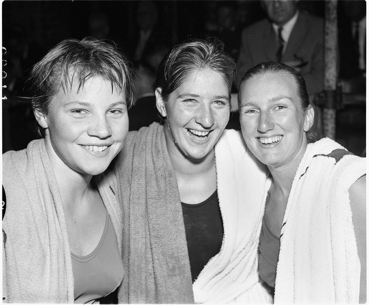 Ilsa Konrads, Dawn Fraser and Lorraine Crapp, at the Australian National Swimming Championships and Olympic Trials, North Sydney Olympic Pool, 1960.  Find more detailed information about this photograph:    http://acms.sl.nsw.gov.au/item/itemDetailPaged.aspx?itemID=72737    From the collection of the State Library of New South Wales http://www.sl.nsw.gov.au
