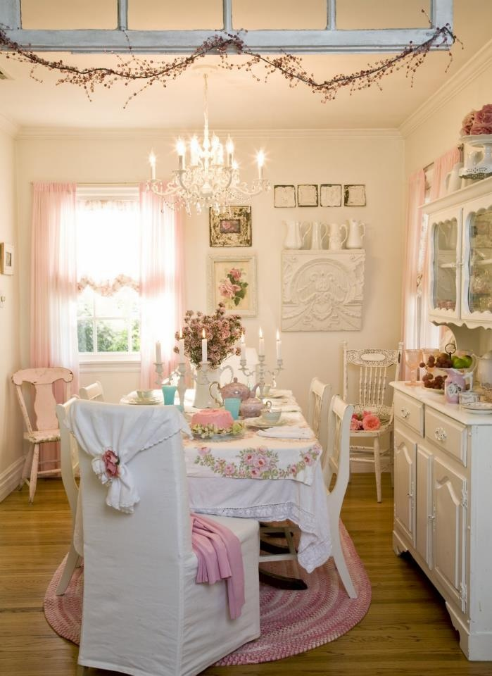Shabby chic dining room with vintage linens crystal chandelier covered chair white pink romantic cottage