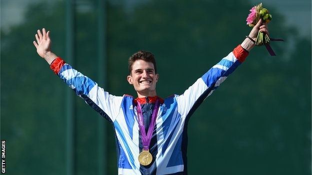 Peter Wilson celebrates gold in the Shooting