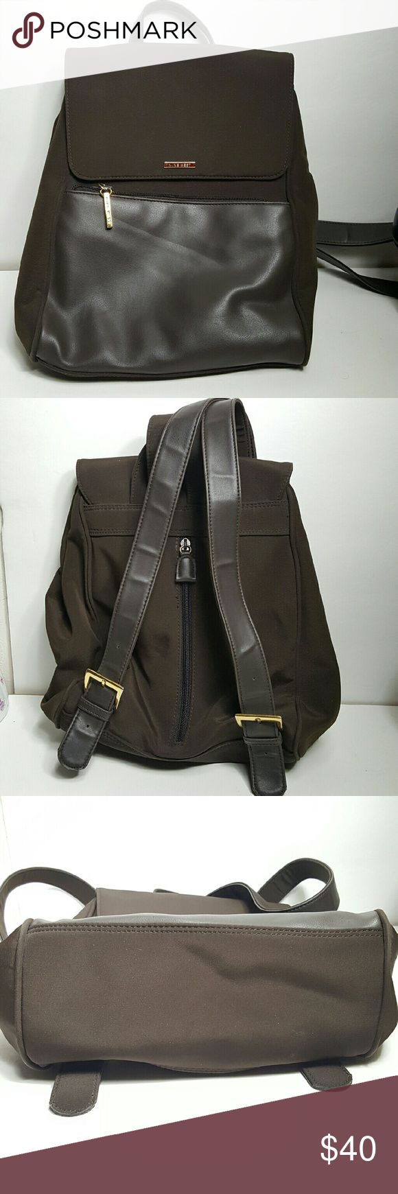 """Sleek and stylish Nine West Backpack Beautiful and Fashionable backpack brown cloth and vinyl trim.  Measures 12"""" wide 11"""" Tall approx. Nine West Bags Backpacks"""